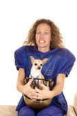 Woman football player. dog in helmet — Photo