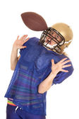 Woman football player hit in helmet with ball — Stock Photo