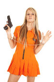 Prisoner orange gun hands up — Stock Photo