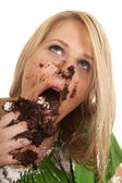 Woman green shirt with cake mess close look up — Stock Photo
