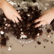 Woman hands messy in cake — Stock Photo #45460211