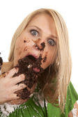 Woman gree shirt with cake stuff in mouth — Stock Photo