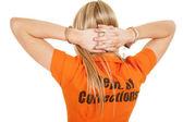 Prisoner orange back hands behind head — Stock Photo