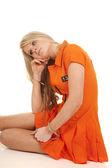 Prisoner orange handcuffs sit hand cheek — Stock Photo
