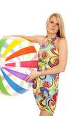 Woman colorful dress hold beach ball — Stock Photo