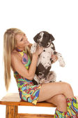 Woman colorful dress sit hold and look at dog — Stock Photo