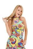 Woman colorful dress twir hair — Stock Photo