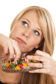 Woman eating jellybeans look up — Stock Photo