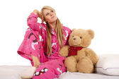 Woman pink pajamas bear sit look side — Stock Photo