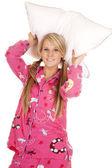Woman pink pajamas pillow behind her head — Stock Photo