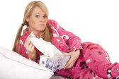 Woman pink pajamas tissue pull frown — Stock Photo