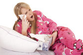 Woman pink pajamas tissue wipe eye — Stock Photo