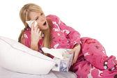 Woman pink pajamas tissue wipe eye — Stock Photo