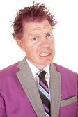 Man in a purple suit close purple hair — Stockfoto