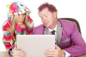 Man with computer and woman in pajama — Stock Photo