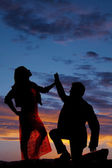 Silhouette man kneel touch womans hand — Stock Photo