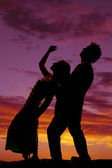 Silhouette man woman bend back her hand up — Stock Photo