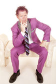 Man in purple suit thinking — Stock Photo