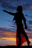 Silhouette woman lacy dress reach out — Stock Photo