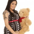 Pregnant woman holding her teddy bear — Stock Photo #47652085