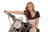 Woman and motorcycle look — Stock Photo