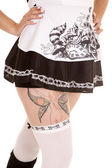 Woman with tattoo on hip — Stock Photo