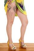 Woman show legs fairy tattoo — Stock Photo