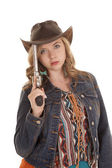 Woman pistol on hat — Stock Photo