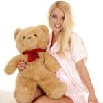 Woman in pajamas holding bear — Stock Photo #48288511