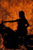 Silhouette pregnant woman and fire — Stock Photo