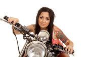 Woman sitting on motorcycle — Stock Photo