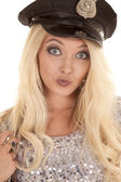 Woman in police hat head smirk — Stockfoto