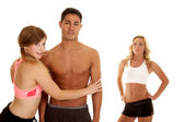 Fitness man with two women one mad — Foto de Stock