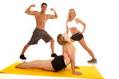 Man and two women workout together — Stock Photo