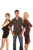 Man between two women hands in pockets — Stock Photo