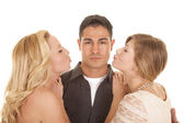 Two women ready to kiss man close — Stock Photo
