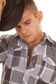 Man plaid shirt putting on hat close — Stock Photo