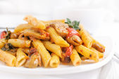 Pasta penne with roasted pepper and mushrooms — Stock Photo
