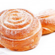 Freshly baked sweet bun with cinnamon - Stock Photo