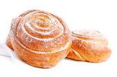 Freshly baked sweet bun with cinnamon — Stock Photo
