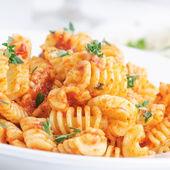 Italian pasta radiatore with tomato sauce — Stock Photo