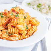 Pasta radiatore with tomato sauce — Stock Photo