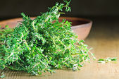 Fresh thyme on the wooden table — Stock Photo