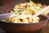 Pasta tagliatelle with bolgnese sauce on the wooden table — Stock Photo