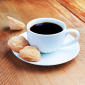 A cup of coffee on the wooden table — Stock Photo