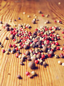 Pepper seeds on the wooden table — Stock Photo