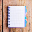 Stock Photo: Notepad on the wooden table