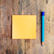 Sticky note and a pencil  on the wooden table — Stock Photo
