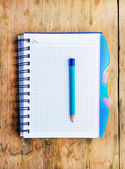 Notepad and a pencil on the wooden table — Foto Stock