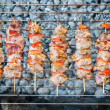 Skewered pork meat with vegetables grilled on barbecue — Stock Photo